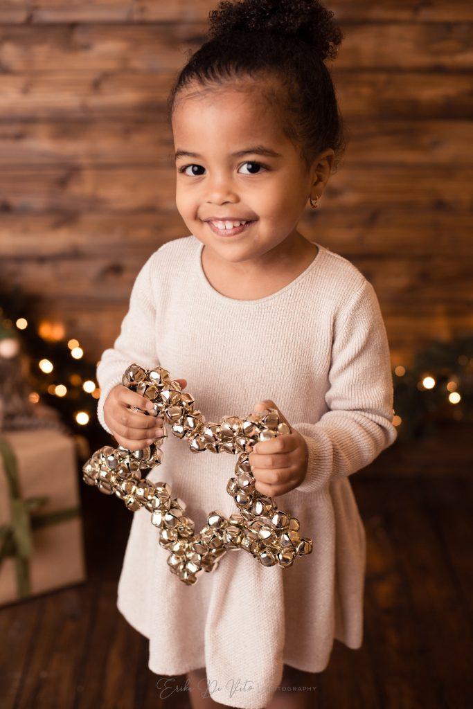 bambina con stella fotografia a tema natale