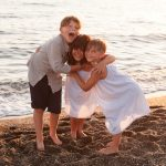 fotografo di bambini tramonto al mare